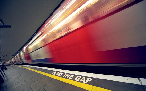Mind the Gap sign in the London Underground - a metaphor for making sure you pay attention to your expenses and create household profits.